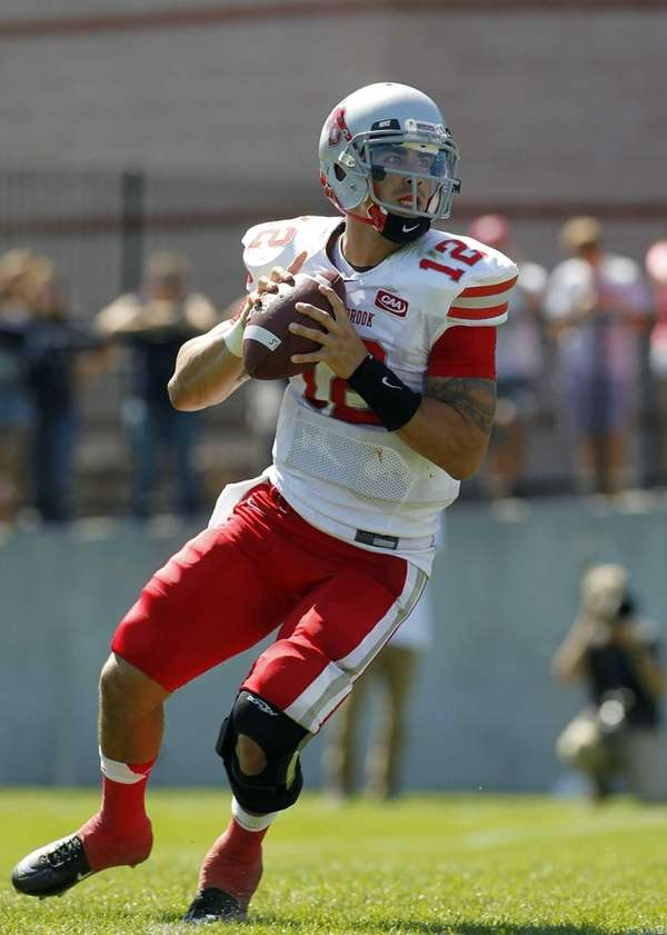 Stony Brook Sewolves quarterback Lyle Negron drops back