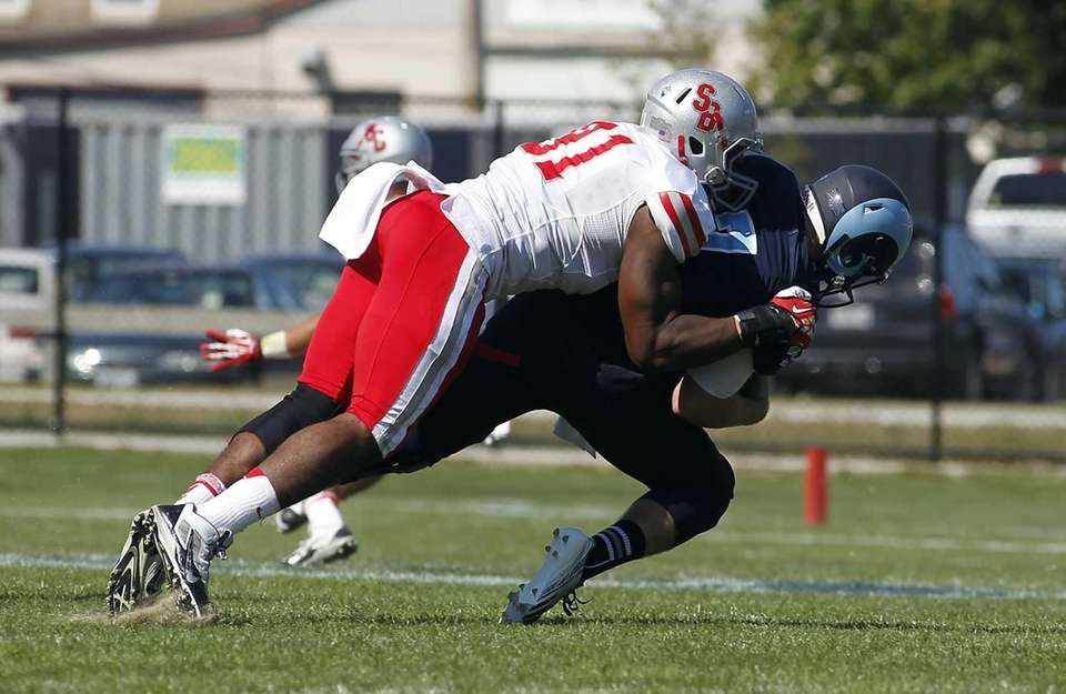 Stony Brook Seawolves defensive lineman Victor Ochi (91)