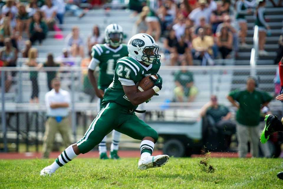 Holy Trinity running back Phillip Crawford sprints forward
