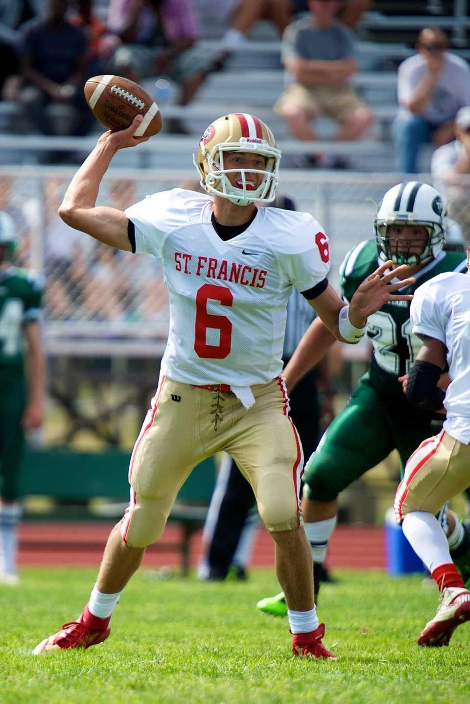 St. Francis (Buffalo) quarterback Jacob Dolegala looks for