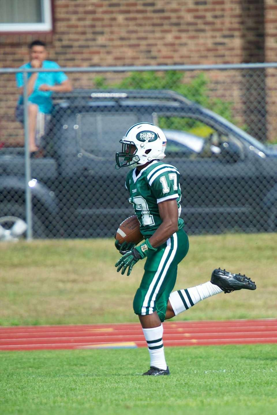 Holy Trinity receiver Kristian Green sprints down the