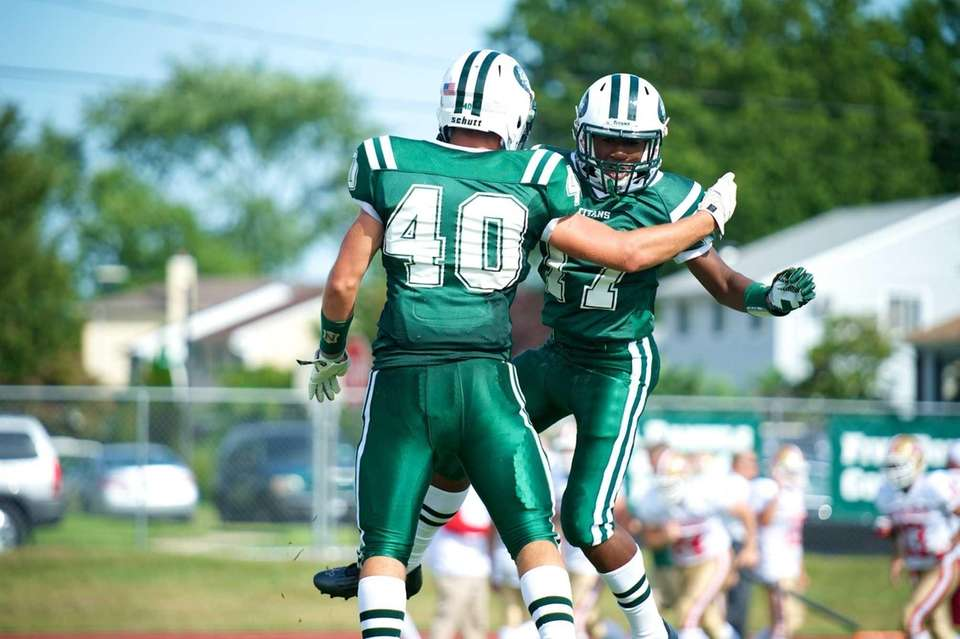 Holy Trinity receiver Kristian Green (no. 17) celebrates