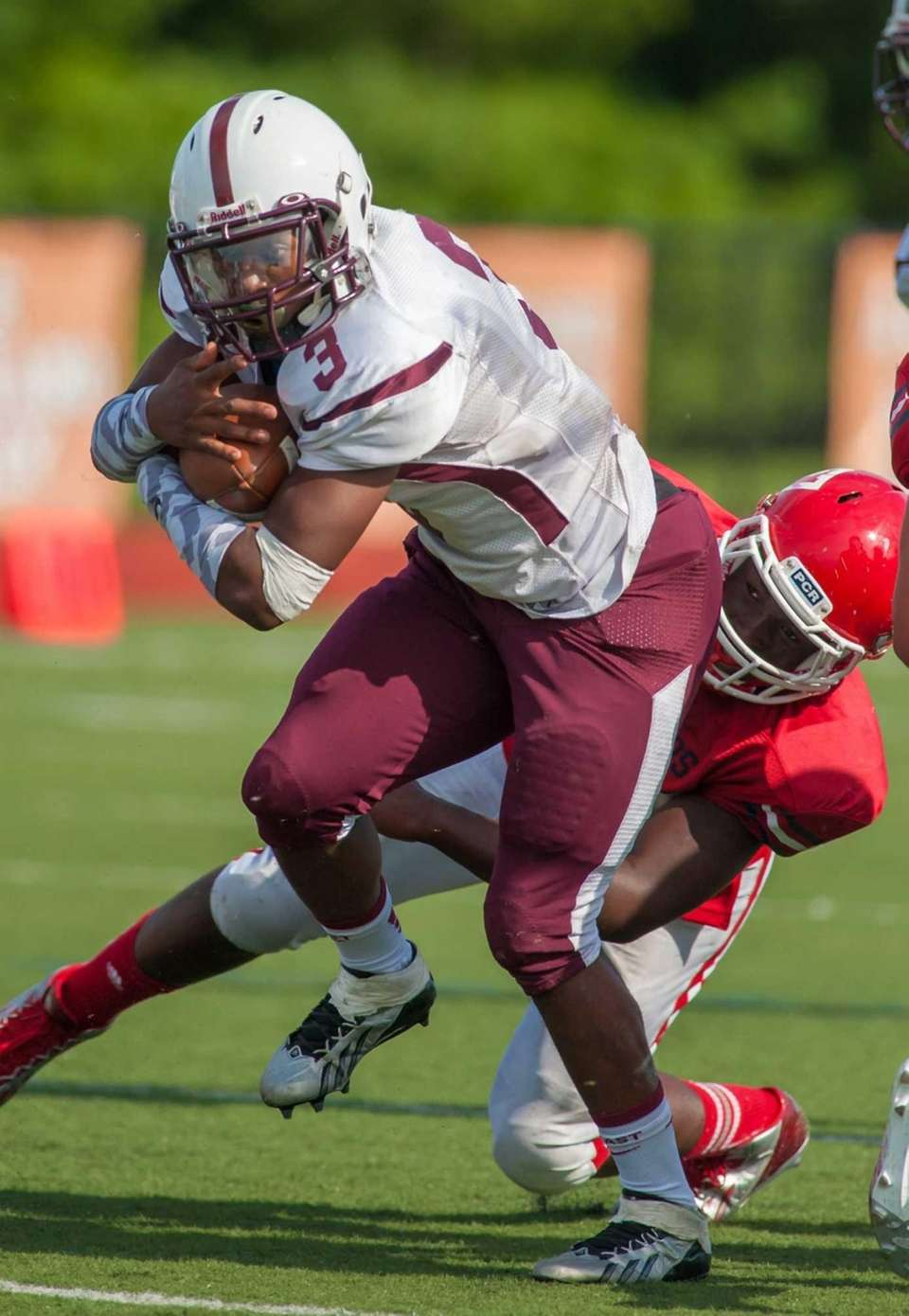 Fordham Prep's Malik Crossdale (3, left) gains some