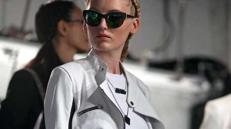 A model poses at the Kenneth Cole Fashion