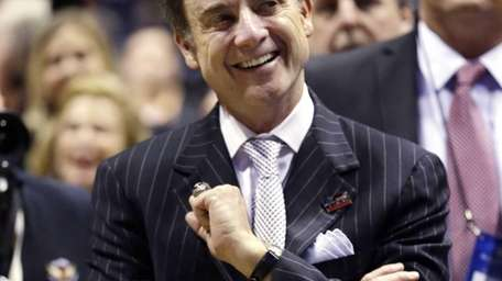 Louisville head coach Rick Pitino celebrates after defeating