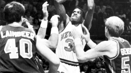 Knicks' Bernard King shooting a basket good for