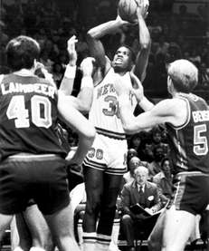 Knicks' Bernard King shooting a basket good for