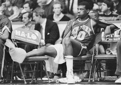Knicks' Bernard King (30) grimaces after injuring his