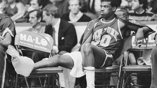 Knicks' Bernard King (30) grimaces after injuring his