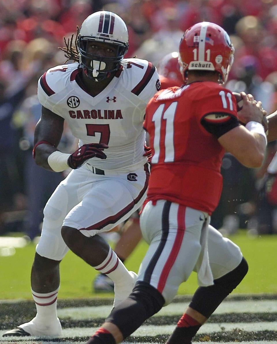 Georgia quarterback Aaron Murray (11) works under pressure