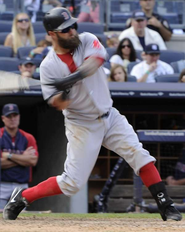 Boston Red Sox hitter Mike Napoli swings for
