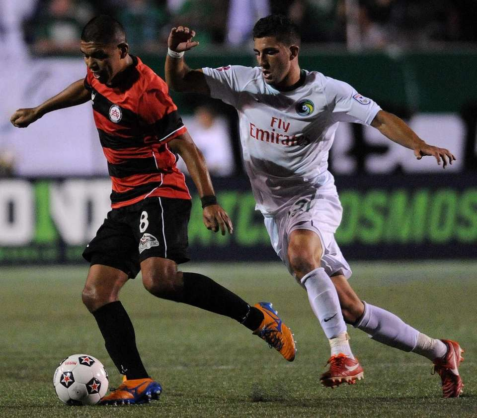 Atlanta Silverbaks midfielder Milton Blanco, left, gets pressured