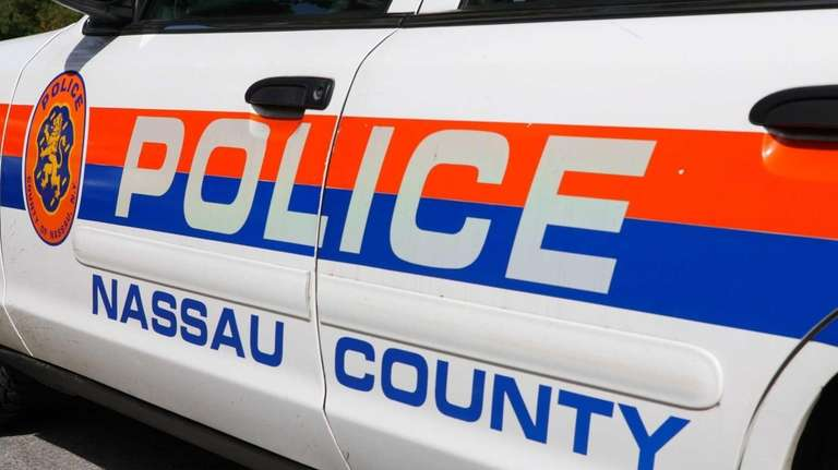 Nassau County police cars sit outside the sixth