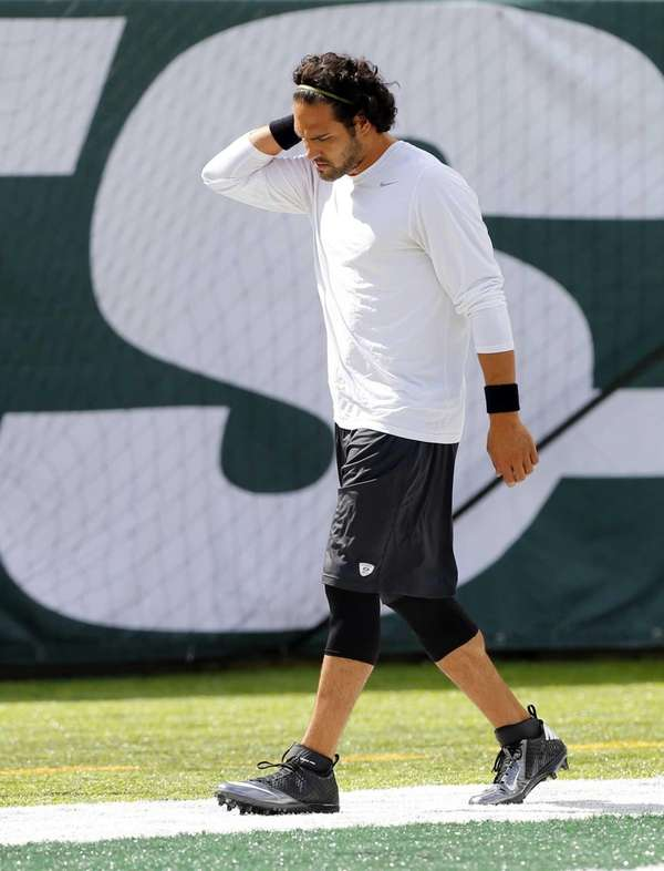 Mark Sanchez warms up before a game against