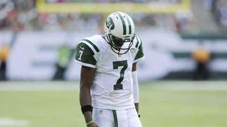 Geno Smith reacts in the first half of
