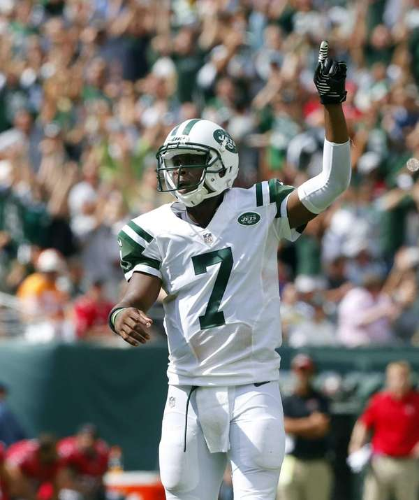 Geno Smith celebrates after throwing his first career
