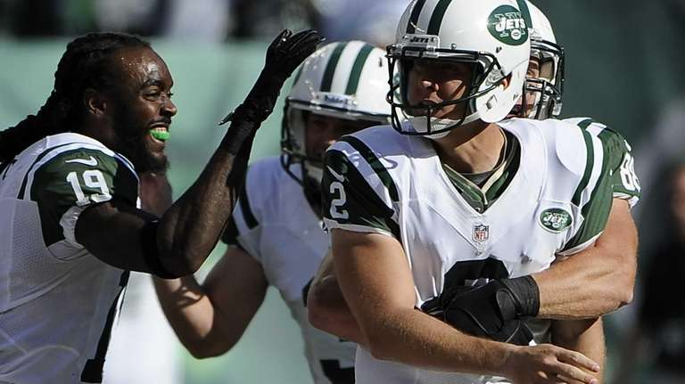 Nick Folk is congratulated by wide receiver Clyde
