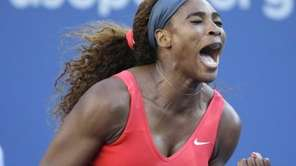 Serena Williams reacts after a point against Victoria