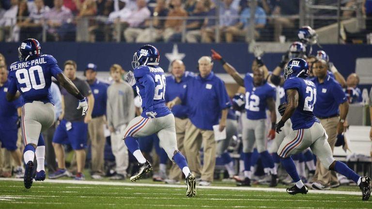 Giants defensive end Jason Pierre-Paul looks to block