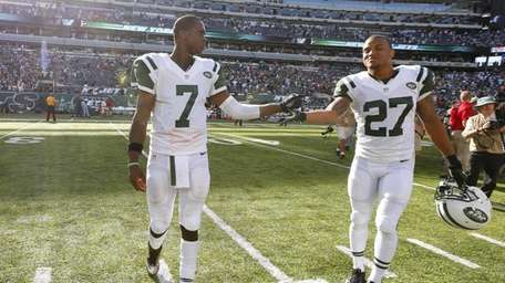 Jets teammates Geno Smith, left, and Dee Milliner