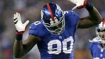Jason Pierre-Paul (90) celebrates a sack during the