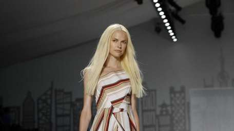 A model presents a creation by Vivienne Tam