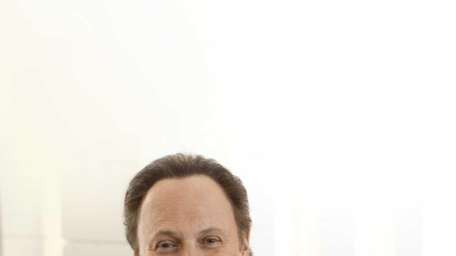 Author and actor Billy Crystal signs his new