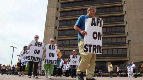 Adjunct Faculty Association members picket Monday outside the