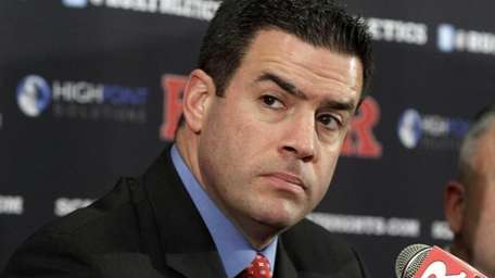 Former Rutgers Athletic Director Tim Pernetti listens to