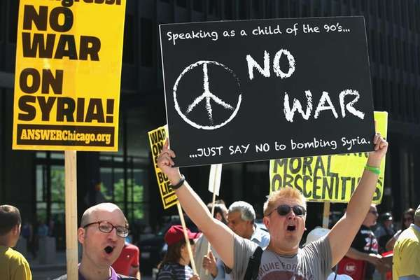 Demonstrators protest against U.S. intervention in Syria in