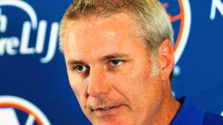 Isles GM Garth Snow addresses the media during