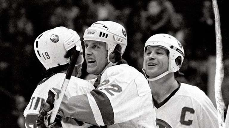 MIKE BOSSY (pictured center) Right wing 58 goals,