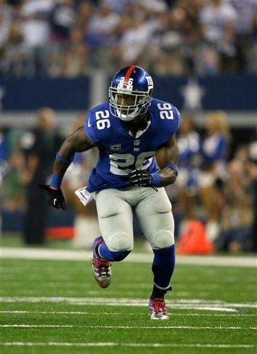Antrel Rolle (26) sprints off the line of