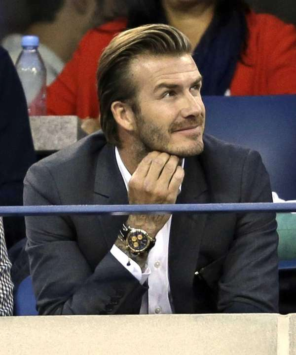 David Beckham watches play between Rafael Nadal and