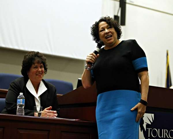 Supreme Court Justice Sonia Sotomayor (front) quips with