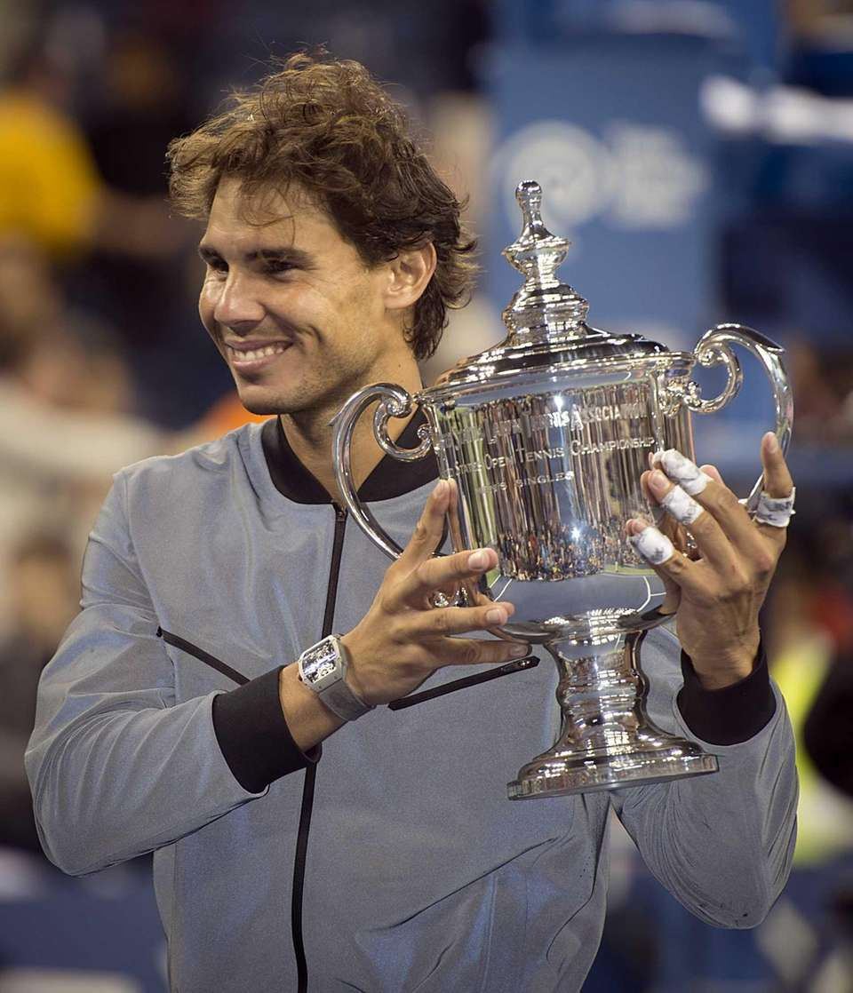 Rafael Nadal holds the winning trophy after defeating