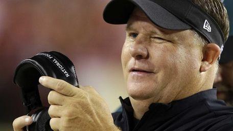 Philadelphia Eagles head coach Chip Kelly winks as