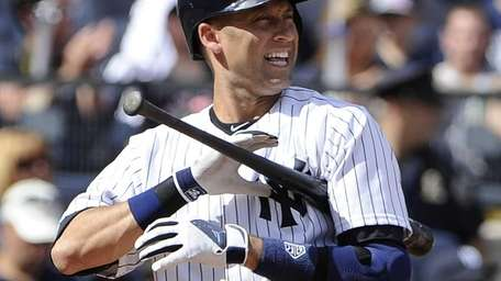 Derek Jeter reacts while at bat in the