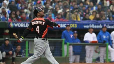 The Netherlands' Wladimir Balentien follows a fly ball
