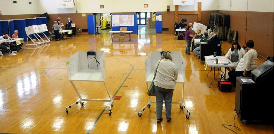 Voters trickle in to cast their ballots in