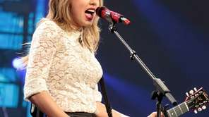 Taylor Swift performs onstage during her Red tour