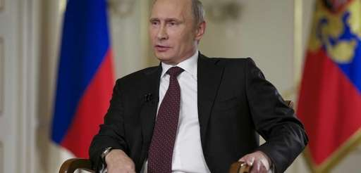 Russian President Vladimir Putin speaks during an interview