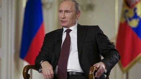 Russian President Vladimir Putin speaks during an interview
