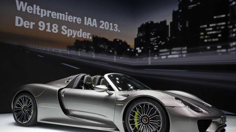 A Porsche 918 Spyder Automobile Stands On Display