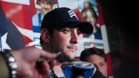 Matt Harvey speaks with reporters while on a