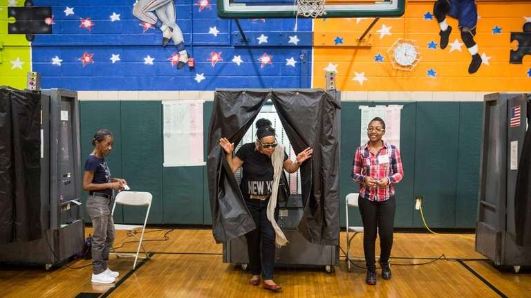 A woman votes in the New York City