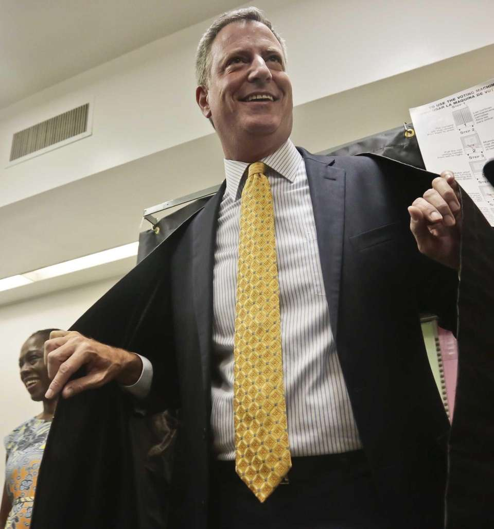 Mayoral candidate Bill De Blasio emerges after casting