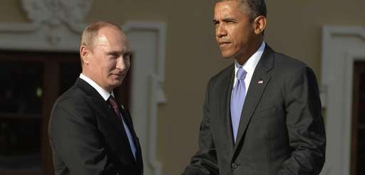 Russias President Vladimir Putin welcomes President Barack Obama