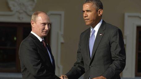 Russias President Vladimir Putin welcomes President Barack Obama