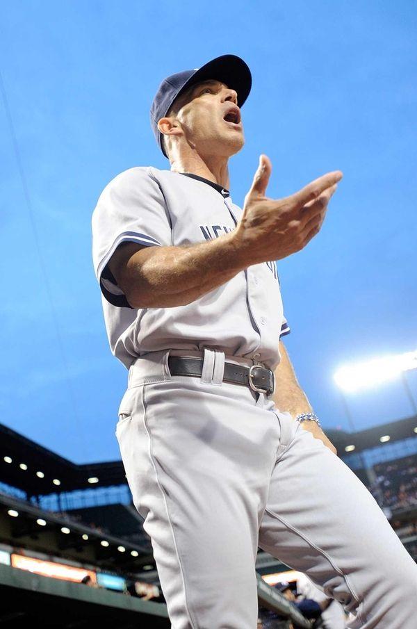 Manager Joe Girardi of the Yankees yells towards